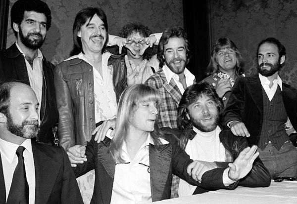 "<div class=""meta image-caption""><div class=""origin-logo origin-image none""><span>none</span></div><span class=""caption-text"">Donnie Dacus, front row center, is introduced as the new lead guitarist of the rock group Chicago, during a press conference in Los Angeles, Calif., on April 12, 1978. (AP Photo/ XCB)</span></div>"