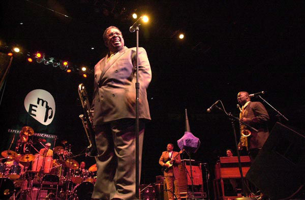 "<div class=""meta image-caption""><div class=""origin-logo origin-image none""><span>none</span></div><span class=""caption-text"">Trombone player Fred Wesley of the JB's warms up the crowd for main attraction James Brown on June 25, 2000, in Seatte. (AP Photo/ JAY DROWNS)</span></div>"