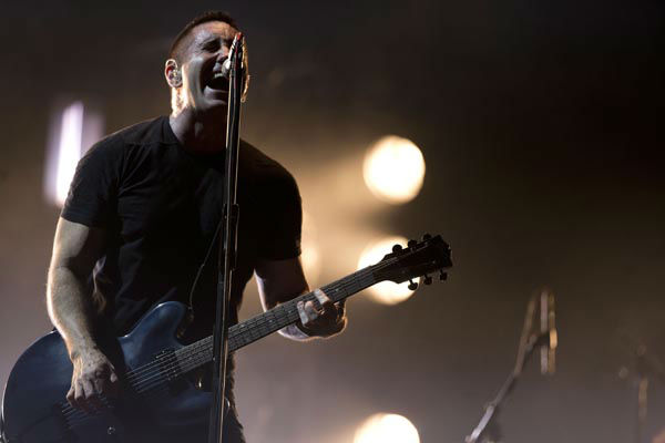 "<div class=""meta image-caption""><div class=""origin-logo origin-image none""><span>none</span></div><span class=""caption-text"">In this March 27, 2014 photo, Trent Reznor of Nine Inch Nails performs at the Vive Latino music festival in Mexico City, Mexico. (AP Photo/ Rebecca Blackwell)</span></div>"