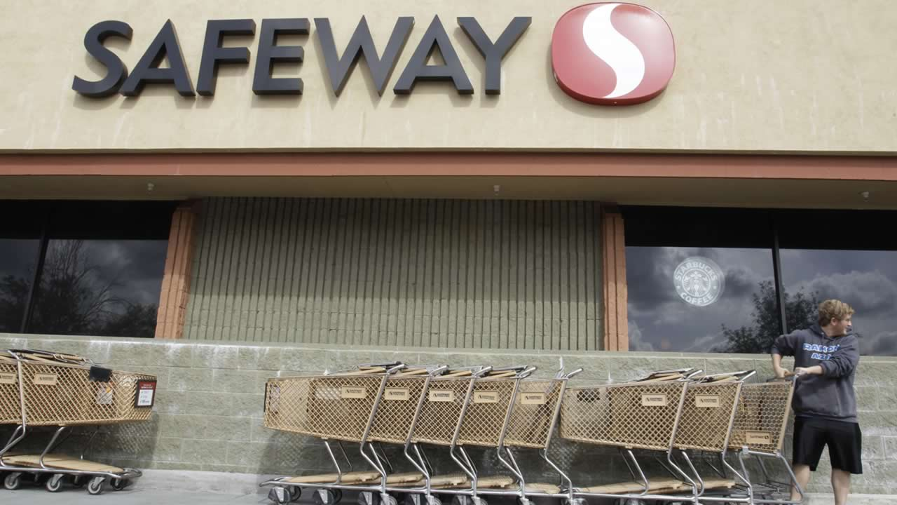 In this Feb. 23, 2011 file photo, a customer grabs a shopping cart at a Safeway store in Cupertino, Calif. (AP Photo/Paul Sakuma, File)