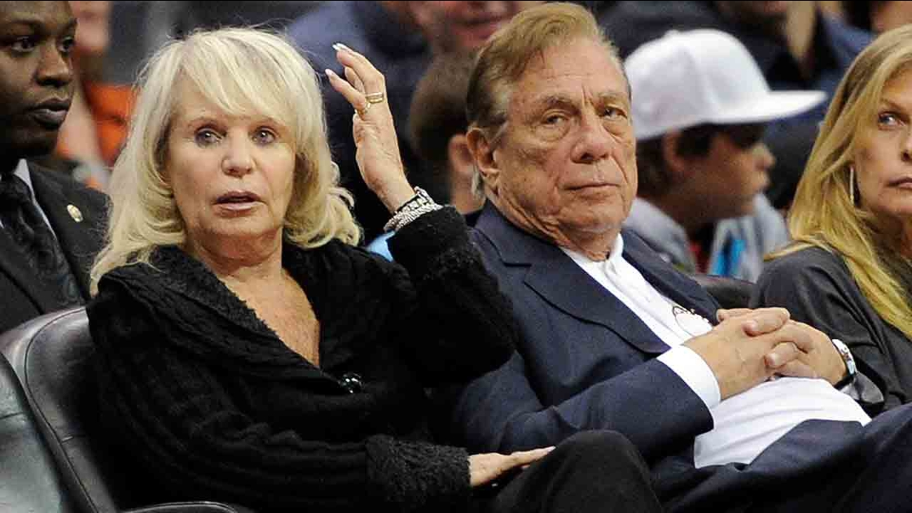 In this Nov. 12, 2010, file photo, Shelly Sterling sits with her husband, Donald Sterling, right, during the Los Angeles Clippers' NBA basketball game against the Detroit Pistons.