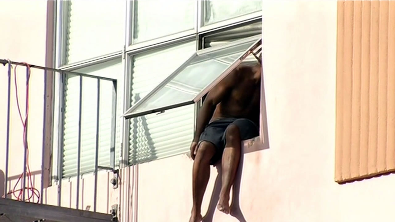 A man threatened to jump from a two-story building window in San Francisco, Calif. on Wednesday, October 7, 2015.