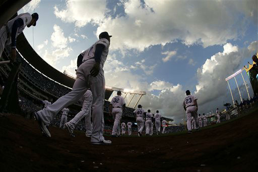 "<div class=""meta image-caption""><div class=""origin-logo origin-image none""><span>none</span></div><span class=""caption-text"">Kansas City Royals players walk onto the field for player introductions (AP Photo/ Charlie Riedel)</span></div>"
