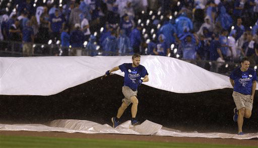 "<div class=""meta image-caption""><div class=""origin-logo origin-image none""><span>none</span></div><span class=""caption-text"">Grounds crew workers put the tarp on the field during a rain delay (AP Photo/ Orlin Wagner)</span></div>"