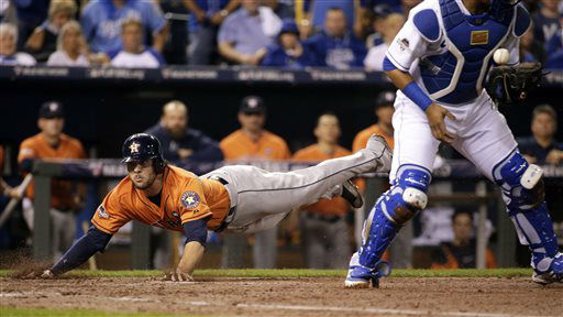 "<div class=""meta image-caption""><div class=""origin-logo origin-image none""><span>none</span></div><span class=""caption-text"">Houston Astros' Jake Marisnick, left, slides safely into home on a single by teammate Jose Altuve (AP Photo/ Charlie Riedel)</span></div>"
