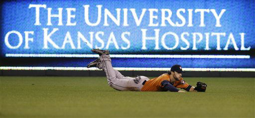 "<div class=""meta image-caption""><div class=""origin-logo origin-image none""><span>none</span></div><span class=""caption-text"">Houston Astros center fielder Jake Marisnick dives to catch a fly ball hit (AP Photo/ Orlin Wagner)</span></div>"