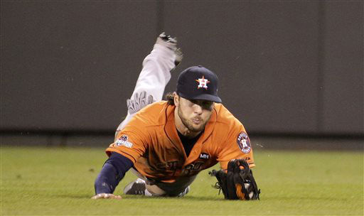 "<div class=""meta image-caption""><div class=""origin-logo origin-image none""><span>none</span></div><span class=""caption-text"">Houston Astros center fielder Jake Marisnick dives to catch a fly ball hit by Kansas City Royals' Alcides Escobar (AP Photo/ Charlie Riedel)</span></div>"