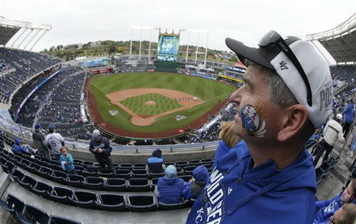 "<div class=""meta image-caption""><div class=""origin-logo origin-image none""><span>none</span></div><span class=""caption-text"">Sean Shanahan, from Lee's Summit, Mo.,  looks out over Kauffman Stadium before Game 2 (AP Photo/ Charlie Riedel)</span></div>"