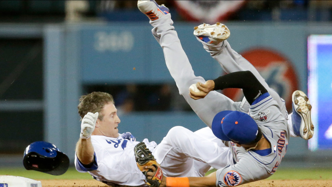 New York Mets shortstop Ruben Tejada, goes over the top of Los Angeles Dodgers' Chase Utley who broke up a double play in Game 2 of baseball's NLDS, Saturday, Oct. 10, 2015.