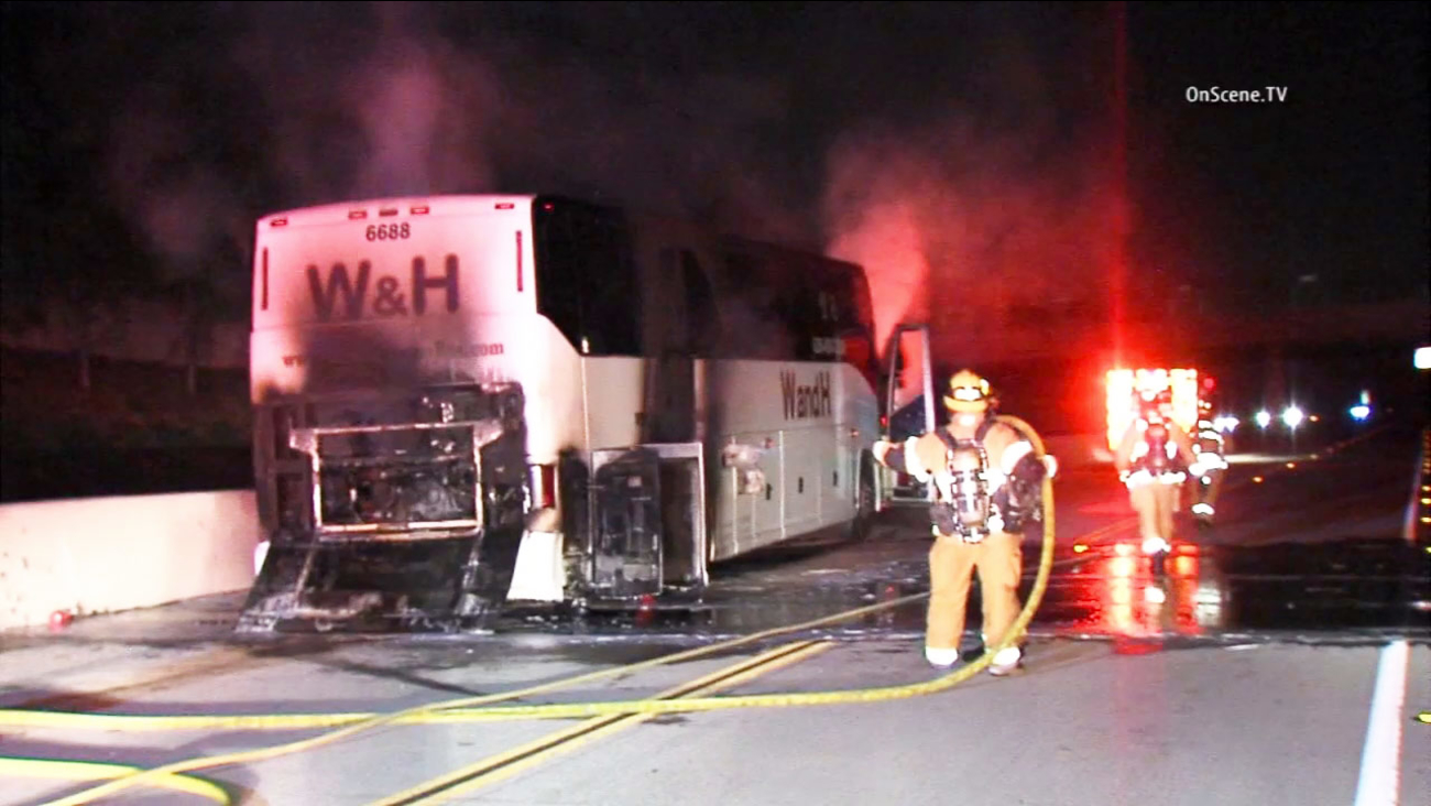 A tour bus caught fire along the westbound 210 Freeway near Foothill Boulevard on Sunday, Oct. 11, 2015.