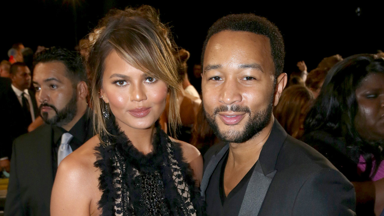 Chrissy Teigen, left, and John Legend arrive at the MTV Video Music Awards at the Microsoft Theater on Sunday, Aug. 30, 2015, in Los Angeles.