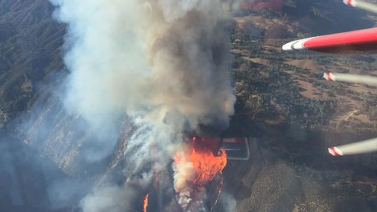 Cal Fire is battling a brush fire that sparked south of Hollister Oct. 12, 2015.