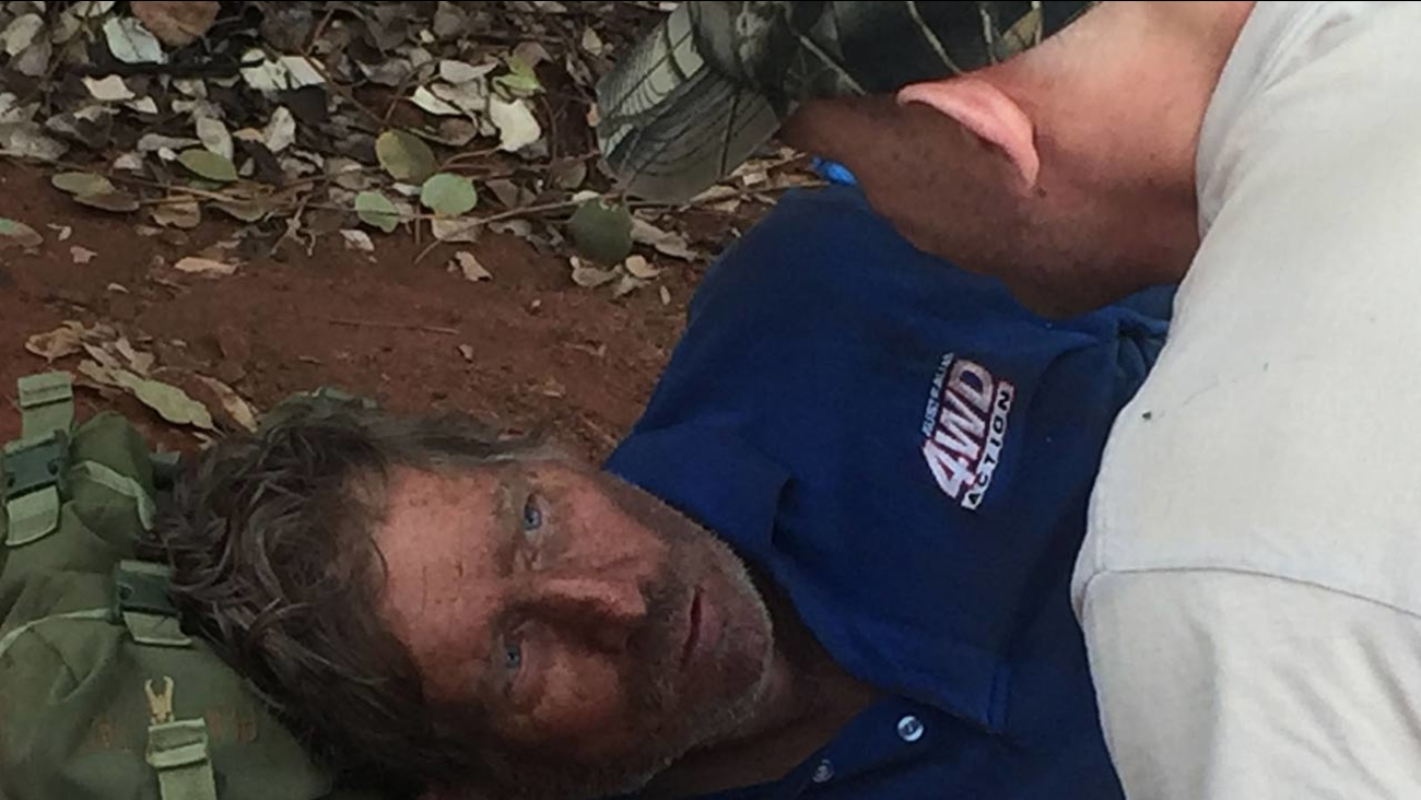 A West Australia Tactical Response Unit officer tends to Reginald George Foggerdy after he was found in an area about 170km east of Laverton, Western Australia.
