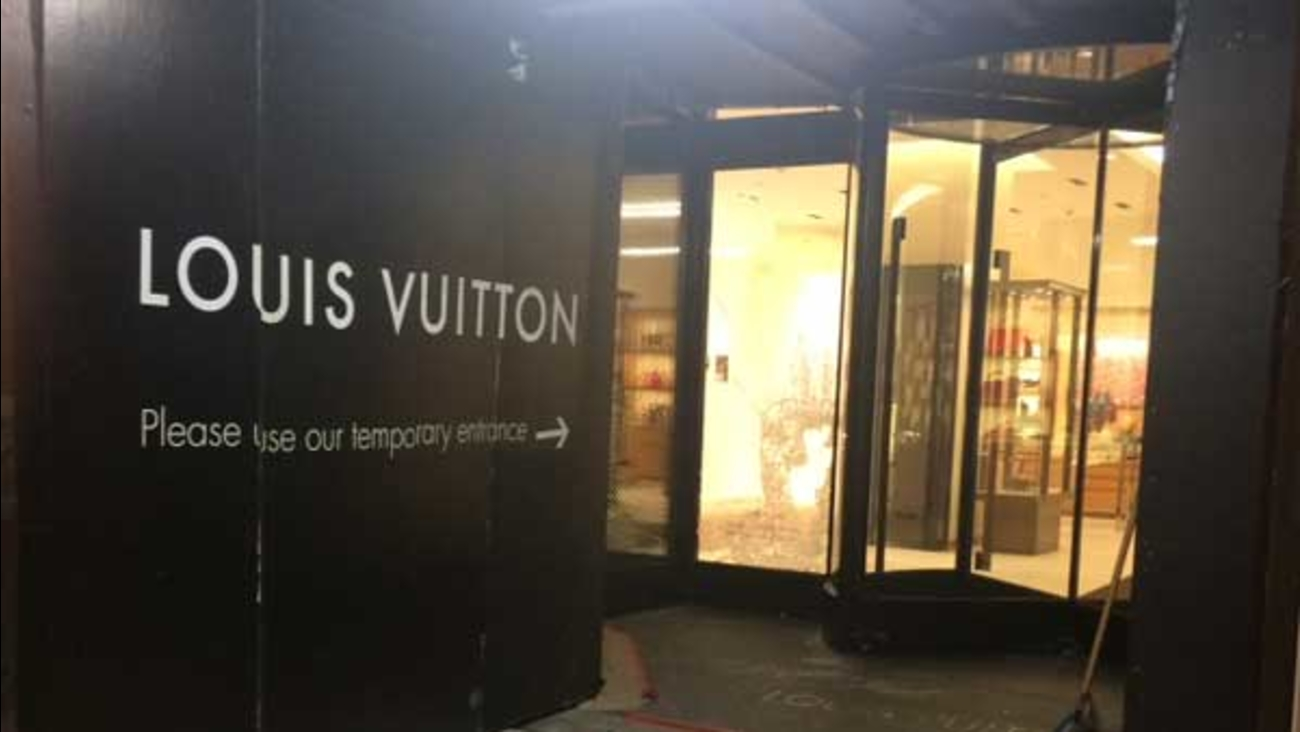 Two men smashed the front glass of the Louis Vuitton store on the Magnificent Mile during an attempted burglary, police said.