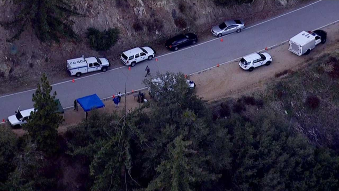 Los Angeles County sheriff's deputies investigate following the discovery of human remains near Glendora Mountain Road and Mile Marker 10.5 on Monday, Oct. 12, 2015.