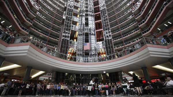 In this March 19, 2013 file photo, soprano Renee Fleming performs with cellist Yo-Yo Ma and a choir students in the rotunda of the James R. Thompson Center in Chicago.