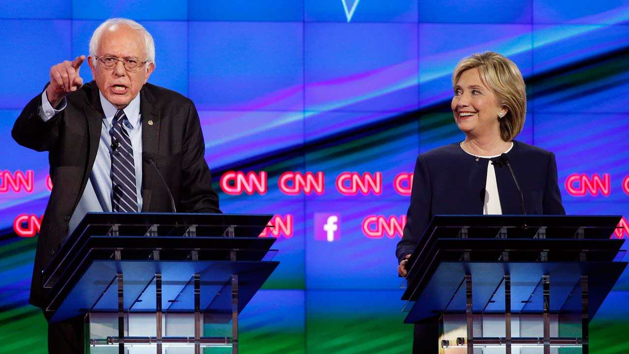 Sen. Bernie Sanders, of Vermont, left, speaks as Hillary Rodham Clinton looks on during the CNN Democratic presidential debate Tuesday, Oct. 13, 2015, in Las Vegas.