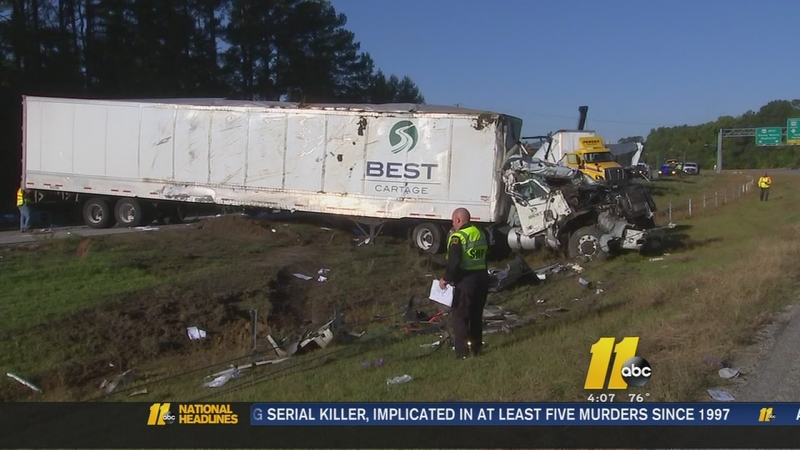 Two tractor trailers overturn