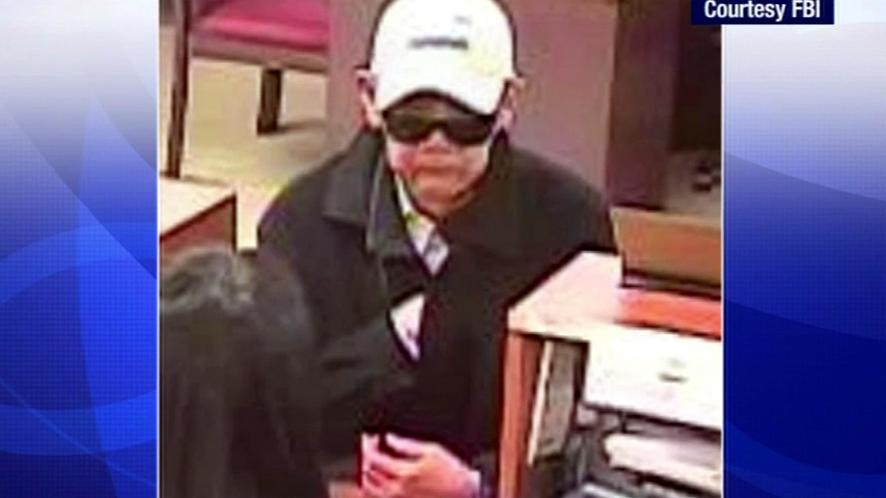 "The FBI is offering a reward of up to $5,000 for information leading to the arrest of a suspect named ""Droopy Face Bandit"" who is accused of robbing at least 10 banks in San Francisco."