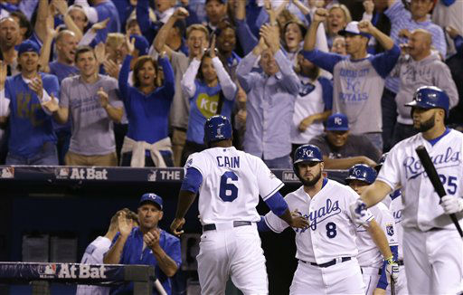 "<div class=""meta image-caption""><div class=""origin-logo origin-image none""><span>none</span></div><span class=""caption-text"">Kansas City Royals' Lorenzo Cain (6) is greeted by teammate Mike Moustakas (8) after scoring a run during the fourth inning (AP Photo/ Orlin Wagner)</span></div>"