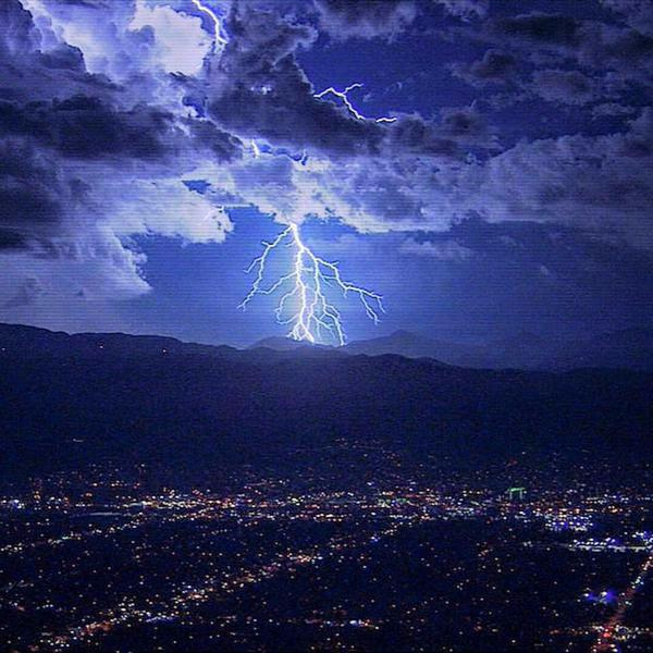 "<div class=""meta image-caption""><div class=""origin-logo origin-image none""><span>none</span></div><span class=""caption-text"">ABC7 viewer Vinny G shared this photo of lightning from Crestline on Wednesday, Oct. 14, 2015. (Twitter/ DannyWoodsGym)</span></div>"