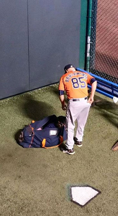 "<div class=""meta image-caption""><div class=""origin-logo origin-image none""><span>none</span></div><span class=""caption-text"">Astros bullpen catcher Javier Bracamonte tosses some goodies to kids following his team's season-ending loss to the Royals. (KTRK Photo/ David Dahmer)</span></div>"