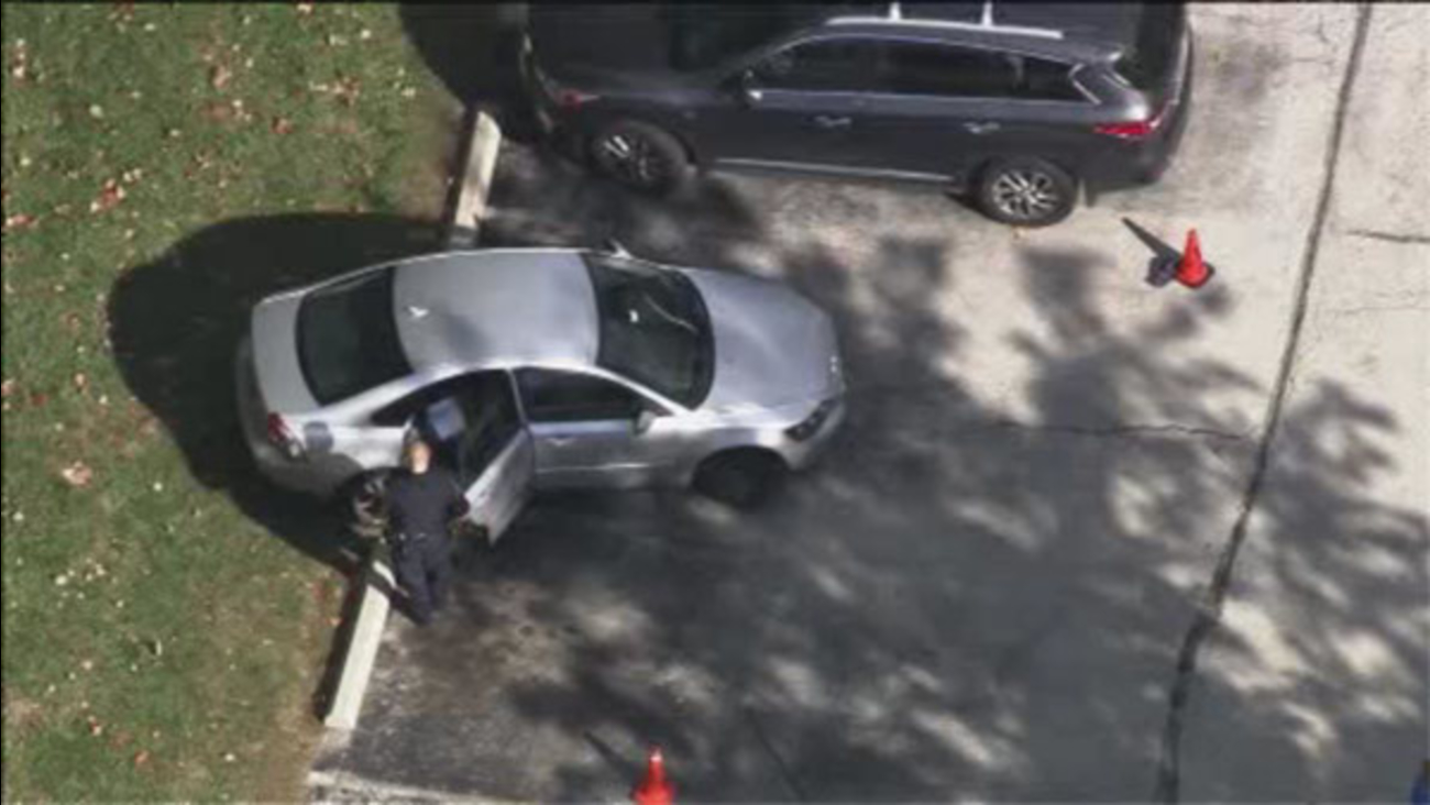 Man becomes trapped under his own car, dies