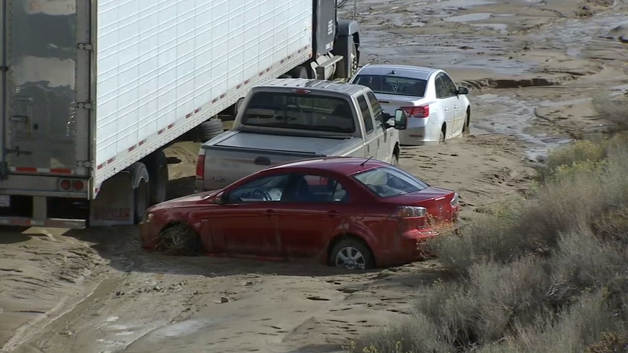 Several cars are stuck inches deep in the mud Friday, Oct. 16, 2015 after rains the day before before caused mud to flow onto the streets in Tehachapi.