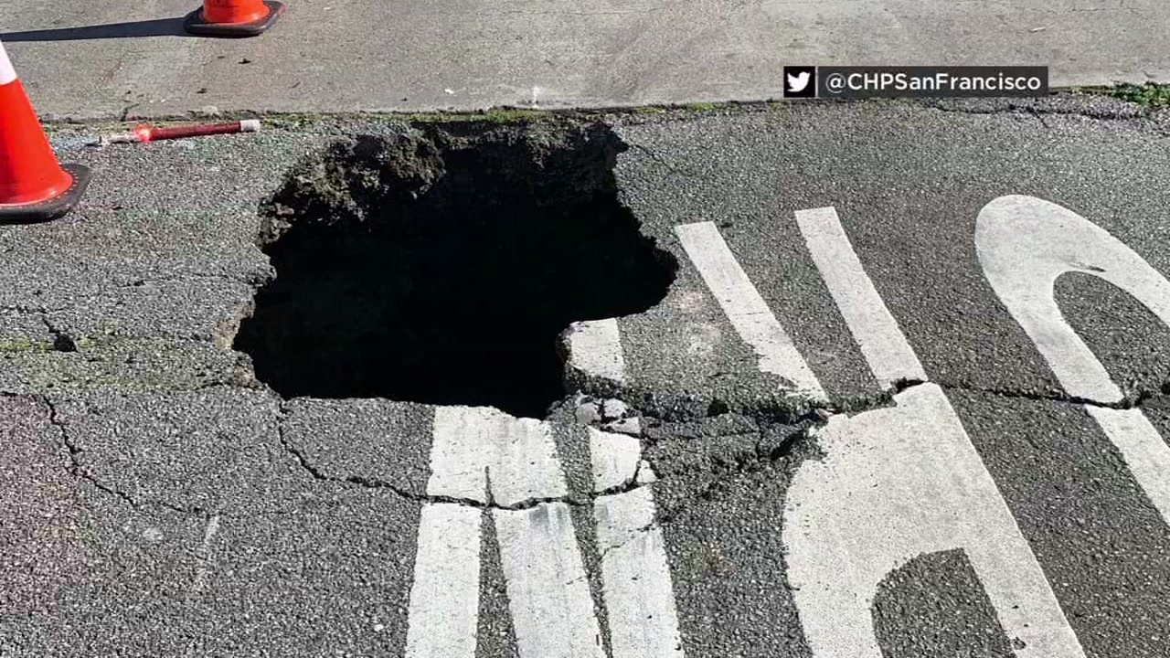 Sinkhole opens up on I-280 off-ramp in San Francisco, causing car to get stuck