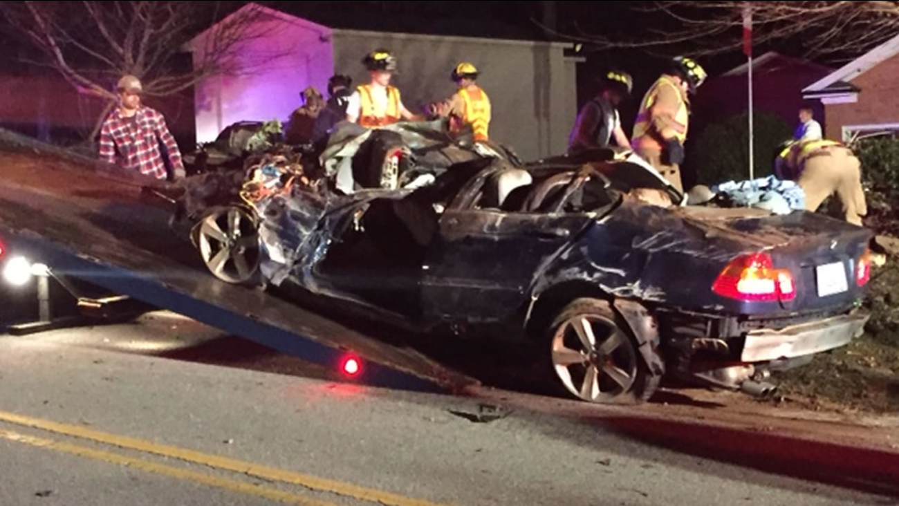 Troopers say the driver of a BMW lost control, hit a wall, and the car flipped over.
