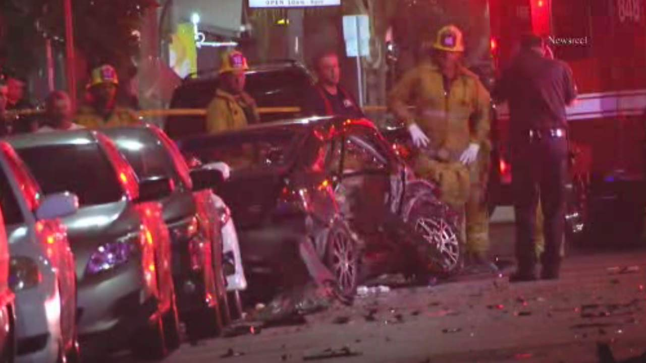 A vehicle is seen crushed after a violent crash killed one person in San Pedro early Saturday, Oct. 17, 2015.