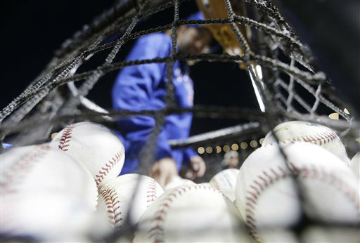 "<div class=""meta image-caption""><div class=""origin-logo origin-image none""><span>none</span></div><span class=""caption-text"">A worker moves baseballs from a basket after batting practice before Game 1. (AP Photo/ David Goldman)</span></div>"