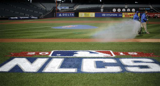 "<div class=""meta image-caption""><div class=""origin-logo origin-image none""><span>none</span></div><span class=""caption-text"">Workers water the infield at Citi Field before Game 1. (AP Photo/ David Goldman)</span></div>"