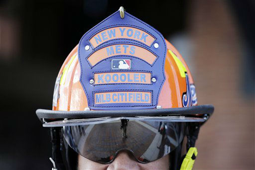 "<div class=""meta image-caption""><div class=""origin-logo origin-image none""><span>none</span></div><span class=""caption-text"">A New York Mets fan wears a helmet supporting his team before the start of Game 1. (AP Photo/ Julie Jacobson)</span></div>"