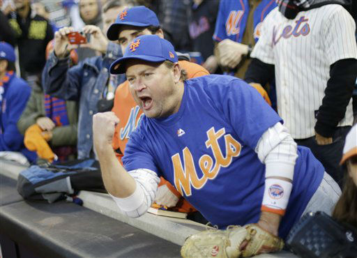 "<div class=""meta image-caption""><div class=""origin-logo origin-image none""><span>none</span></div><span class=""caption-text"">A New York Mets fan cheers before Game 1. (AP Photo/ David Goldman)</span></div>"