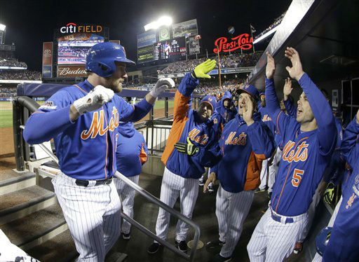 "<div class=""meta image-caption""><div class=""origin-logo origin-image none""><span>none</span></div><span class=""caption-text"">New York Mets' Daniel Murphy is congratulated after hitting a home run during the first inning of Game 1. (AP Photo/ David J. Phillip)</span></div>"