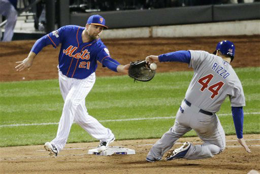 "<div class=""meta image-caption""><div class=""origin-logo origin-image none""><span>none</span></div><span class=""caption-text"">Chicago Cubs' Anthony Rizzo is hit in the hand as he slides safely back to first in front of New York Mets' Lucas Duda on a pick off attempt. (AP Photo/ David Goldman)</span></div>"