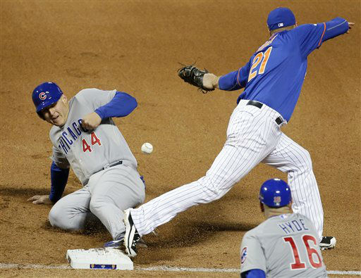 "<div class=""meta image-caption""><div class=""origin-logo origin-image none""><span>none</span></div><span class=""caption-text"">Chicago Cubs' Anthony Rizzo is hit in the hand as he slides safely back to first in front of New York Mets' Lucas Duda on a pick off attempt. (AP Photo/ Frank Franklin II)</span></div>"