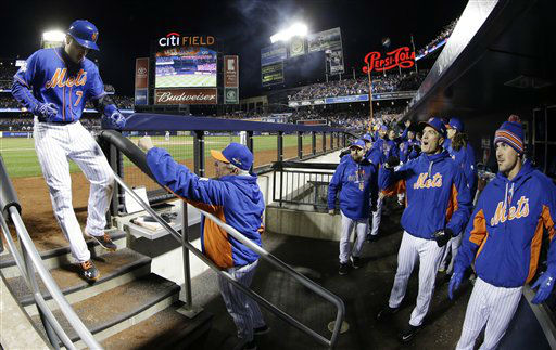 "<div class=""meta image-caption""><div class=""origin-logo origin-image none""><span>none</span></div><span class=""caption-text"">New York Mets' Travis d'Arnaud is congratulated by manager Terry Collins after hitting a home run during the sixth inning of Game 1. (AP Photo/ David J. Phillip)</span></div>"