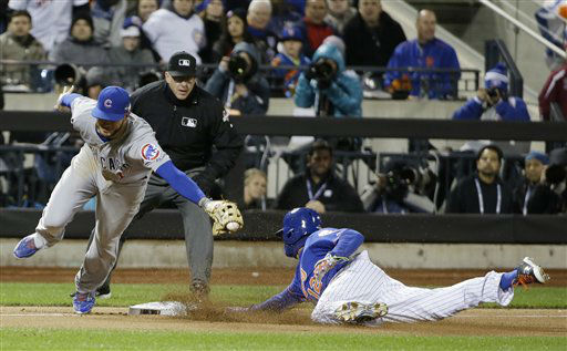 "<div class=""meta image-caption""><div class=""origin-logo origin-image none""><span>none</span></div><span class=""caption-text"">New York Mets' Juan Lagares steals third with Chicago Cubs' Kris Bryant covering during the seventh inning of Game 1. (AP Photo/ David J. Phillip)</span></div>"