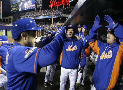 "<div class=""meta image-caption""><div class=""origin-logo origin-image none""><span>none</span></div><span class=""caption-text"">New York Mets' Travis d'Arnaud is congratulated in the dugout after hitting a home run during the sixth inning of Game 1. (AP Photo/ David J. Phillip)</span></div>"