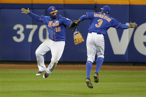 "<div class=""meta image-caption""><div class=""origin-logo origin-image none""><span>none</span></div><span class=""caption-text"">New York Mets' Juan Lagares (12) and Curtis Granderson (3) celebrate after Game 1. (AP Photo/ David J. Phillip)</span></div>"