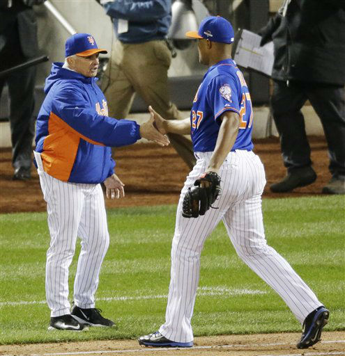"<div class=""meta image-caption""><div class=""origin-logo origin-image none""><span>none</span></div><span class=""caption-text"">New York Mets manager Terry Collins congratulates Jeurys Familia after Game 1. (AP Photo/ David Goldman)</span></div>"