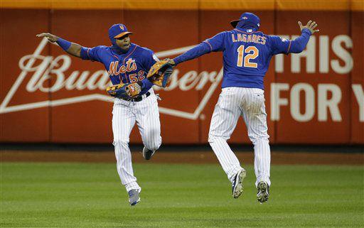 "<div class=""meta image-caption""><div class=""origin-logo origin-image none""><span>none</span></div><span class=""caption-text"">New York Mets' Yoenis Cespedes (52) and Juan Lagares (12) celebrate after Game 1. (AP Photo/ David J. Phillip)</span></div>"