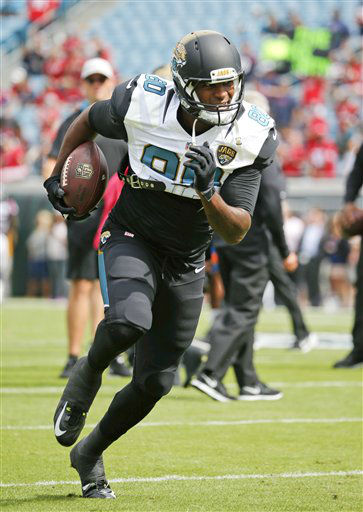 "<div class=""meta image-caption""><div class=""origin-logo origin-image none""><span>none</span></div><span class=""caption-text"">Jacksonville Jaguars tight end Julius Thomas (80) warms up before an NFL football game against the Houston Texans in Jacksonville, Fla. (AP Photo/ Stephen B. Morton)</span></div>"