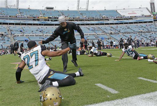 "<div class=""meta image-caption""><div class=""origin-logo origin-image none""><span>none</span></div><span class=""caption-text"">Jacksonville Jaguars head coach Gus Bradley, center, greets cornerback Dwayne Gratz (AP Photo/ John Raoux)</span></div>"