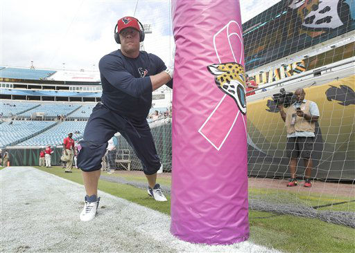 "<div class=""meta image-caption""><div class=""origin-logo origin-image none""><span>none</span></div><span class=""caption-text"">Houston Texans defensive end J.J. Watt warms up next to a  goal post bringing attention to Breast Cancer Awareness month (AP Photo/ Phelan M. Ebenhack)</span></div>"
