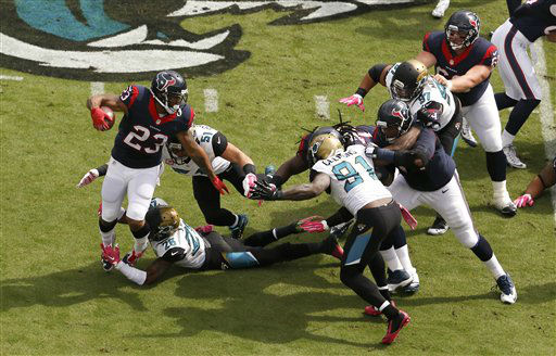 "<div class=""meta image-caption""><div class=""origin-logo origin-image none""><span>none</span></div><span class=""caption-text"">Houston Texans running back Arian Foster (23) runs against the Jacksonville Jaguars (AP Photo/ Stephen B. Morton)</span></div>"