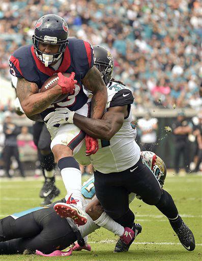 "<div class=""meta image-caption""><div class=""origin-logo origin-image none""><span>none</span></div><span class=""caption-text"">Houston Texans running back Arian Foster, top left, scores a touchdown on a 14-yard pass play past Jacksonville Jaguars (AP Photo/ Phelan M. Ebenhack)</span></div>"