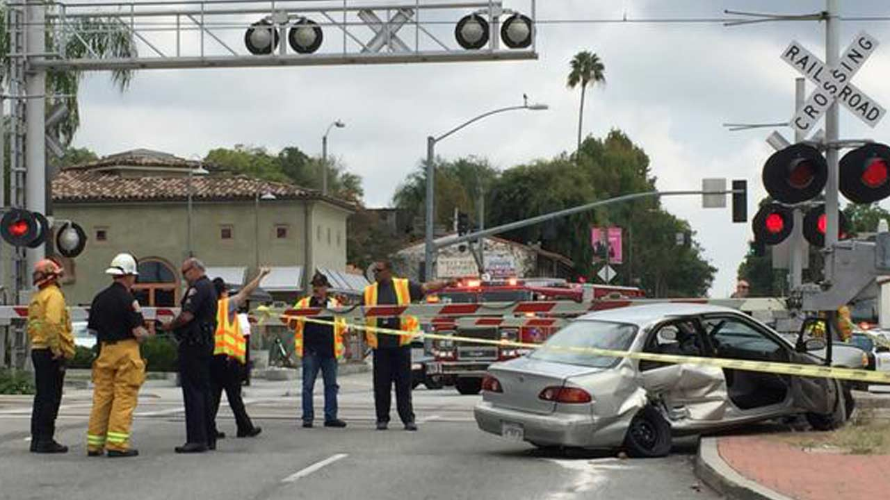 A Toyota Corolla is seen crushed after a crash involving a Metro Gold Line train and the vehicle Sunday, Oct. 18, 2014.